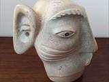 "Atta (Good Listener) BBrazilian soapstone, black pearl stone height: 16"" width 10"" depth: 16"""