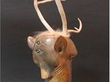 Memories of Hunting (2004) Soapstone, Antler,  Mahogany Wood Base, inlay